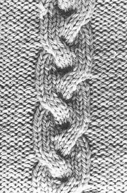 Tricot torsade nattée